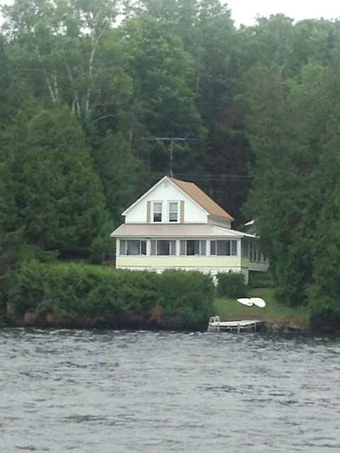 White cottage as seen from the water