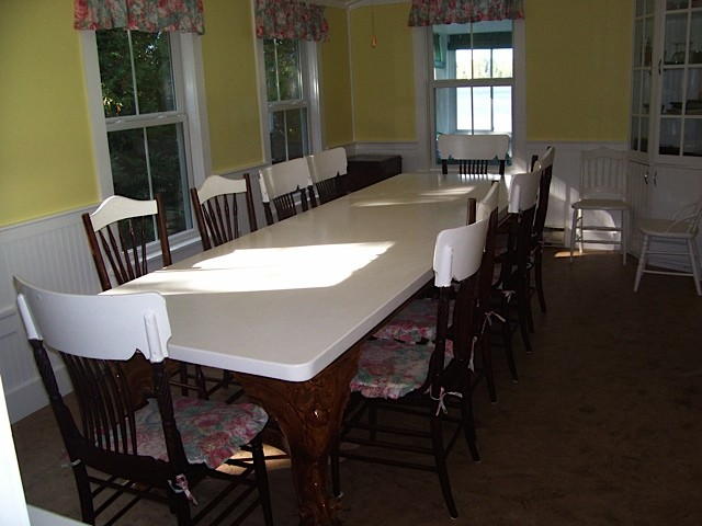 Large formal table in White Cottage with white top and chairs