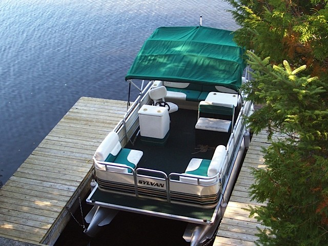 Canopied boat docked on the water