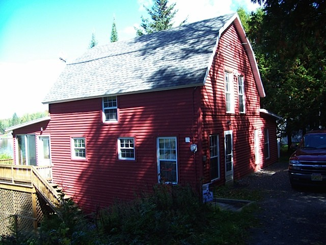 Red cottage in shade