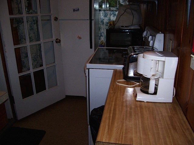 Red cottage's stove and cooking area in kitchen